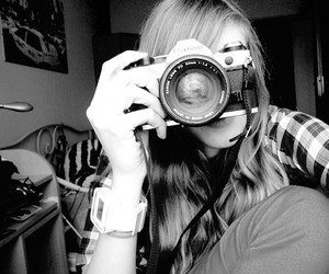 black and white, blonde, and camera image