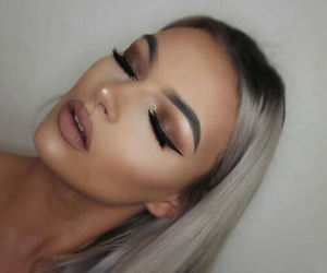 matte lipstick, brown eyeshadow, and flawless eyelashes image
