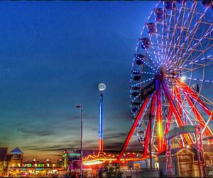 boardwalk, ferris wheel, and ocean city image