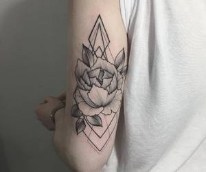 arm, hand, and tattoo image