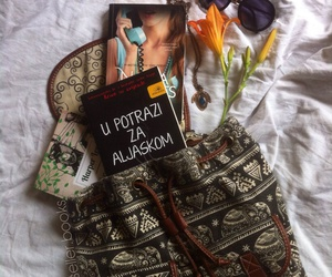 backpack, bed, and books image