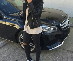 black leather jacket, adidas sneakers, and big curly black hair image