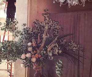 chandelier, flowers, and vase image
