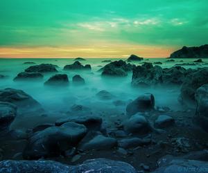 beach, lake, and rocks image