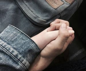 couple, denim, and hands image