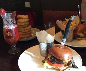 burgers, chips, and cocktail image