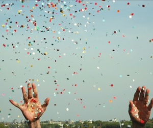 sky, hands, and confetti image