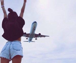 girl, plane, and sky image