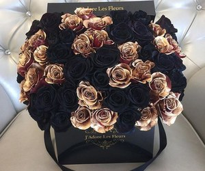 black, gold, and flowers image