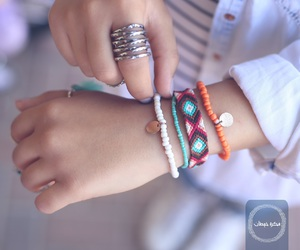 bracelets, green, and white image