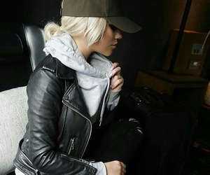 black leather jacket, grey hoodie, and black ripped jeans image
