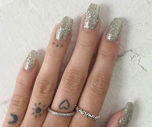 finger tattoo, heart tattoos, and silver rings image