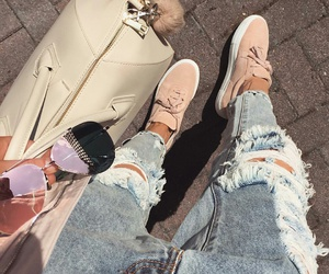 aviator sunglasses, light blue ripped jeans, and fur keychain image
