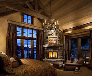 bedroom, cabin, and fireplace image
