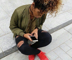 green shirts, gold layered necklaces, and red sneakers image