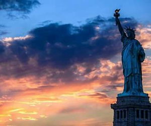 sky, city, and statue of liberty image