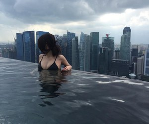 girl, city, and water image