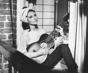 audrey hepburn, Breakfast at Tiffany's, and guitar image