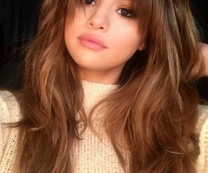 selena gomez, long wavy brown hair, and yellow knit turtleneck image