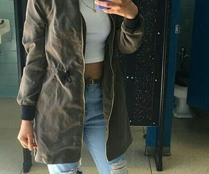 black sneakers, long green jacket, and gold hoops image