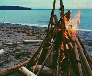 beach, fire, and sea image