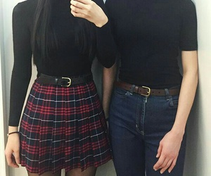 black turtleneck, plaid skirts, and black belt image