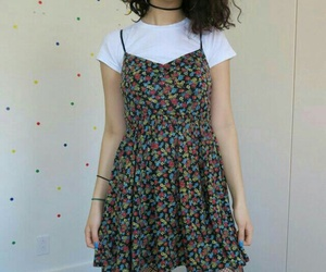 black tights, floral dress, and short curly hair image
