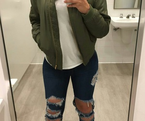 white t-shirts, green bomber jacket, and blue ripped jeans image