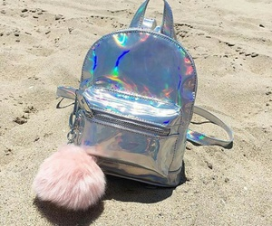 pink fur keychain, small backpack, and silver backpack image