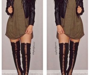 black leather jacket, black thigh high boots, and long curly black hair image