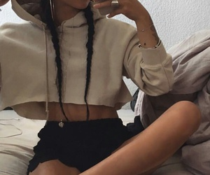 black converse, silver hoops, and long black french braids image