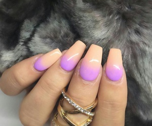 gold rings, long ombre nails, and grey faux fur blanket image