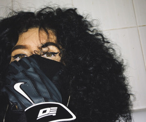 curly hair, eyes, and nike image