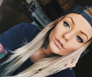 nose piercing and tattoo image