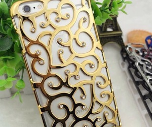 gold, iphone, and gold phone case image