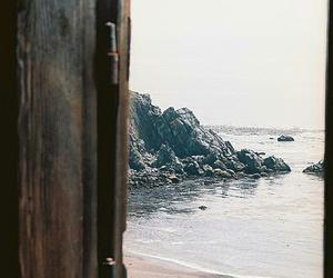 girl, sand, and sea image