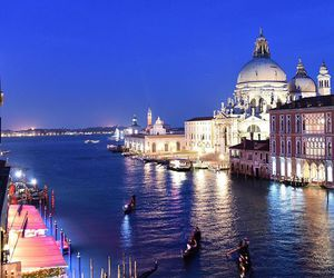 city lights, gondolas, and ocean image