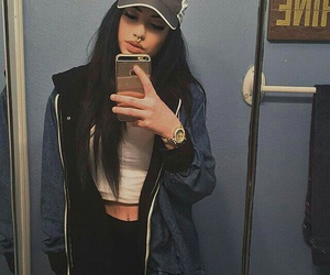 black leggings, gold watches, and long straight black hair image
