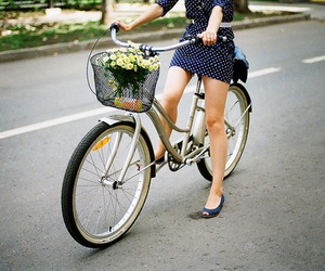 girl, bike, and flowers image