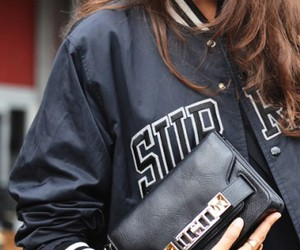 clutch, supreme, and college jacket image