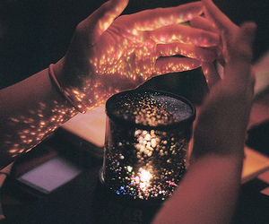 light, hands, and candle image