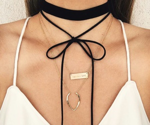 white flowy tank top, black choker necklaces, and gold layered necklaces image
