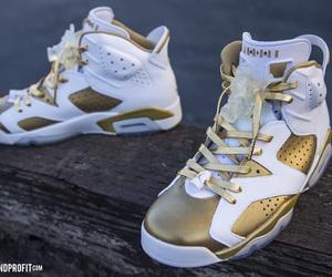 jordans and gold image