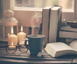 book, candle, and tea image