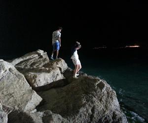 beach, rocks, and seainthenight image