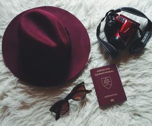 burgundy, camera, and passport image