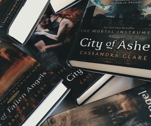 book, the mortal instruments, and read image