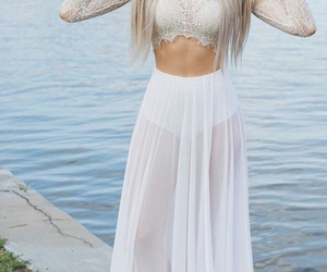 long straight blonde hair, white lace crop tops, and mesh maxi skirts image