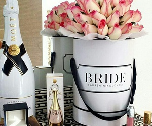 champagne, flowers, and МОЁТ image