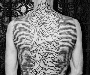 ian curtis, joy division, and unknown pleasures image